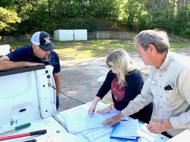 J.B. Raymond, Shelby County Judge Allison Harbison and Pct. 4 County Commissioner Tom Bellmyer are seen at Monday's auction.