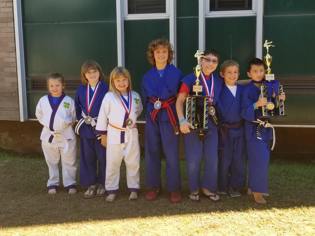 From left to right; Zoey Deas with a 5th in Chanbara Fighting, Caitlyn Madden with a Bronze in Point Sparring, Emma Madden with a Bronze in Point Sparring, Rex Payne with a Silver in Chanbara fighting, Logan Galindo with a 1st trophy in Speciality Forms, and 2 Bronzes  in Weapons and Forms, Zac Payne placed 5th in Chanbara and Point Sparring and Ryder Moody placed 1st place trophy in Point Sparring, Silver in Chanbara and Silver in Forms.