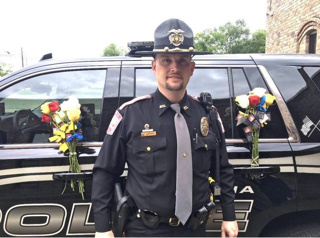 Tenaha Police Chief Jeremy Pope with Mother's Day roses.