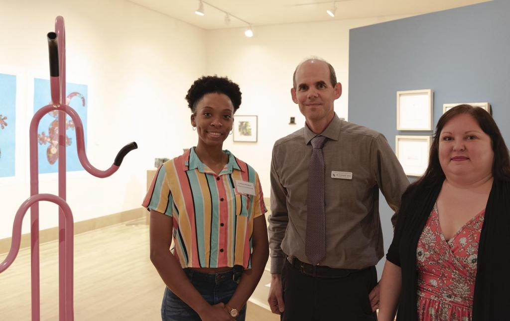 SFA senior art major Typhanie Shepherd of Lufkin, left, has been awarded this year's William Arscott Art Scholarship by the Friends of the Visual Arts at SFA. With Shepherd are Christopher Talbot, director of the SFA School of Art, and Crystal Hicks, FVA president.