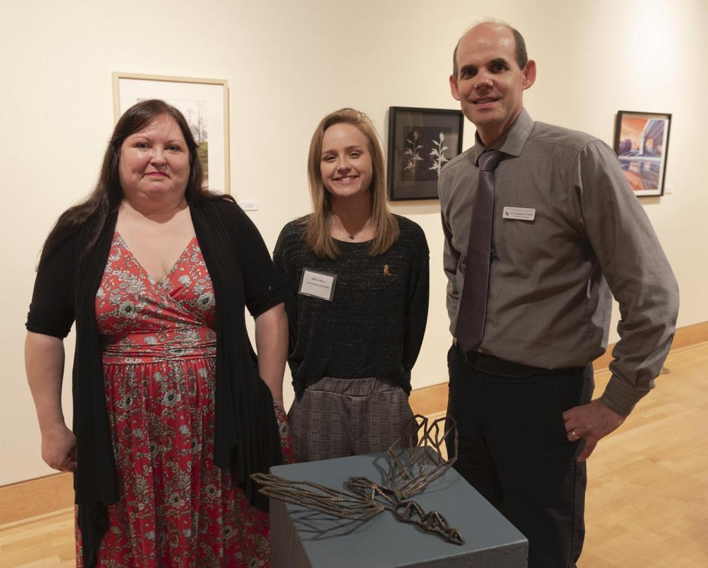 SFA senior sculpture student Allison Silcox of Winnie, center, has been selected by the SFA Friends of the Visual Arts to receive this year's Gary Q. Frields Art Scholarship. Pictured with her are FVA President Crystal Hicks and School of Art Director Christopher Talbot.