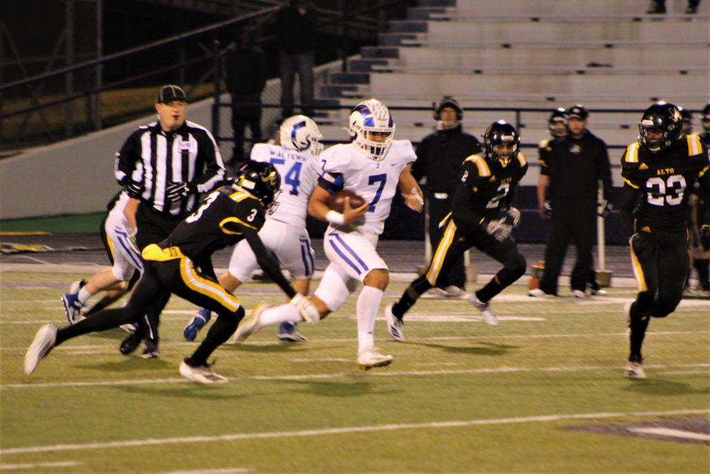 """Lorenzo """"Boogie"""" Lane weaves between Alto defenders during their playoff battle last Friday night. Lane was a force for the Rams, putting up 141 yards and a game winning touchdown. (Photo by Taylor Bragg, Freelance Photographer)"""