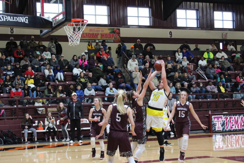 Briley Behrens goes up for a contested jump shot against the defending state champion Martin's Mill Lady Mustangs during the Tenaha Holiday Hoops Tournament. (Photo by Taylor Bragg, Freelance Photographer)