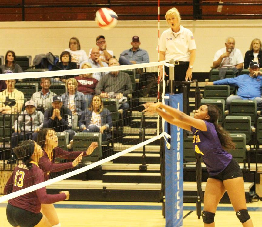 Jasmine Cooks (4) of Center sends the ball back across the net during a  Class 4A, Region III Bi-district match between the Lady Riders and  Fairfield on Monday night in Jacksonville. Cooks had three kills in the  match.