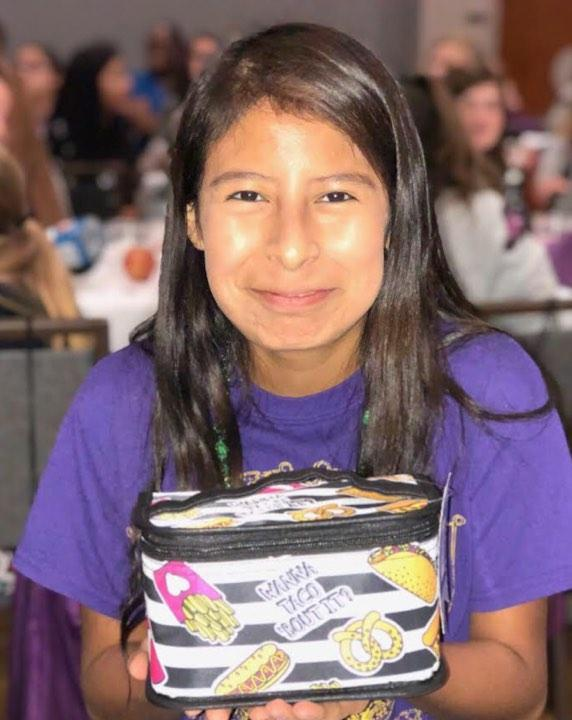 Cristina (pictured) was the recipient of one of several door prizes given to the girls after sessions ended.