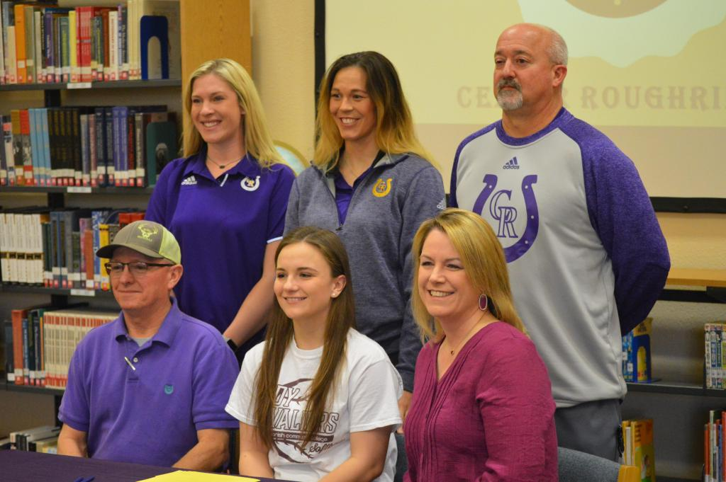 Center High School senior Taylor Nichols (front row center) is joined by her parents, Freeman, left, and Kathy, right. In the back row are Shelby Parker, basketball coach Arianna Randolph, and athletic director Barry Bowman.