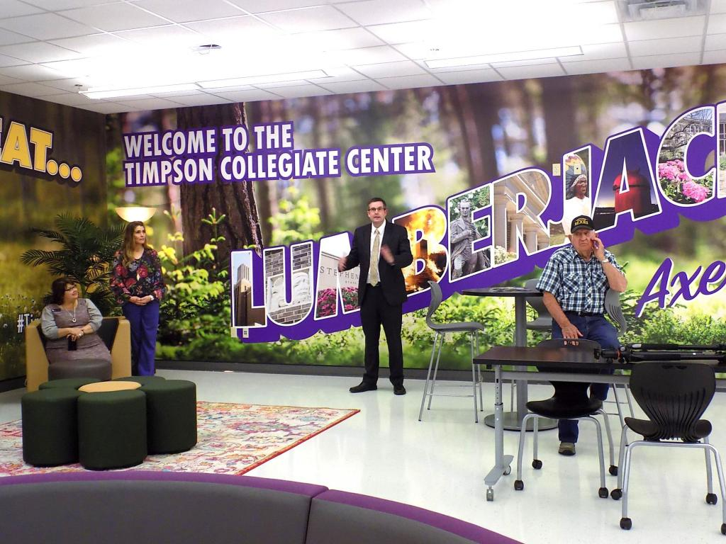 Supt. Mid Johnson addresses the crowd in the commons of the TISD Collegiate Center.