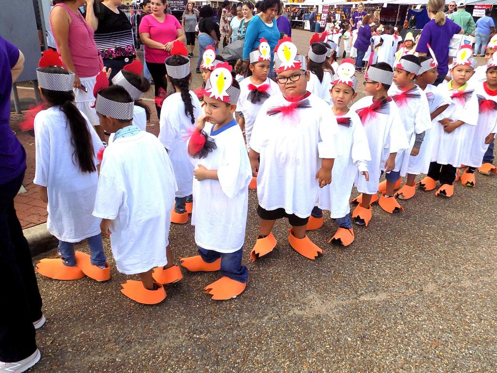 Chicken feet made up part of the attire of the day on Thursday for this group of youngsters preparing to take the stage at the 42nd Annual East Texas Poultry Festival. School classes from across Shelby County participated in singing and dancing to the delight of audiences during the event.