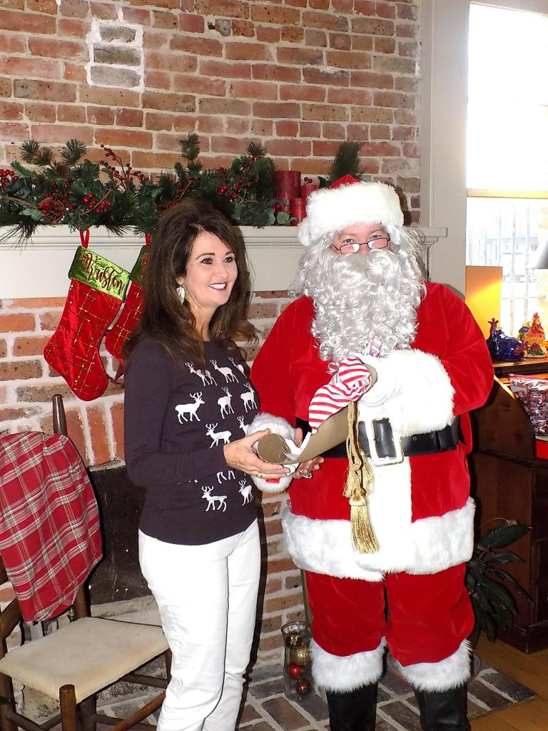 Dr. Jheri-Lynn McSwain, who will serve as Grand Marshal of the 19th annual Santa's Christmas Parade iin Center on Dec. 1, is seen with Santa Claus.
