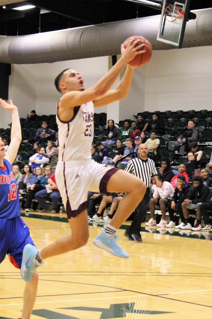 Erik Smith of Tenaha goes airborne on his way to the basket. Smith was all over the floor providing the Tigers with blocks, steals, rebounds, and of course points. (Photo by Taylor Bragg, Freelance Photographer)