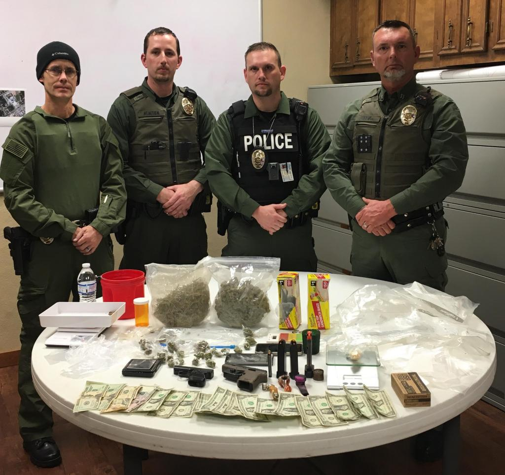 Among items seized were approximately two pounds of marijuana, illegally possessed prescription pills, drug paraphernalia, packaging materials, firearms, and US currency, used to facilitate sales and purchases of illegal narcotics.