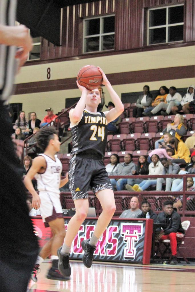 Garrett Askins of Timpson prepares to send the ball to the hoop on a shot from the top of the key. (Photo by Taylor Bragg, Freelance Photographer)
