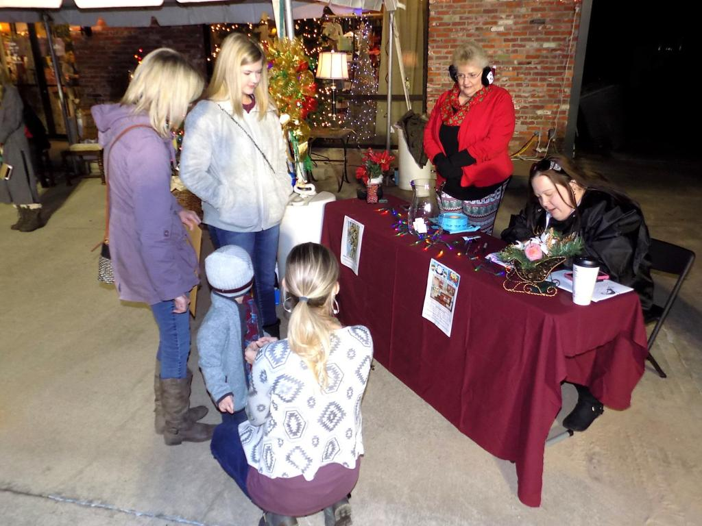 Blue Santa signup at Holiday on Foster last year.