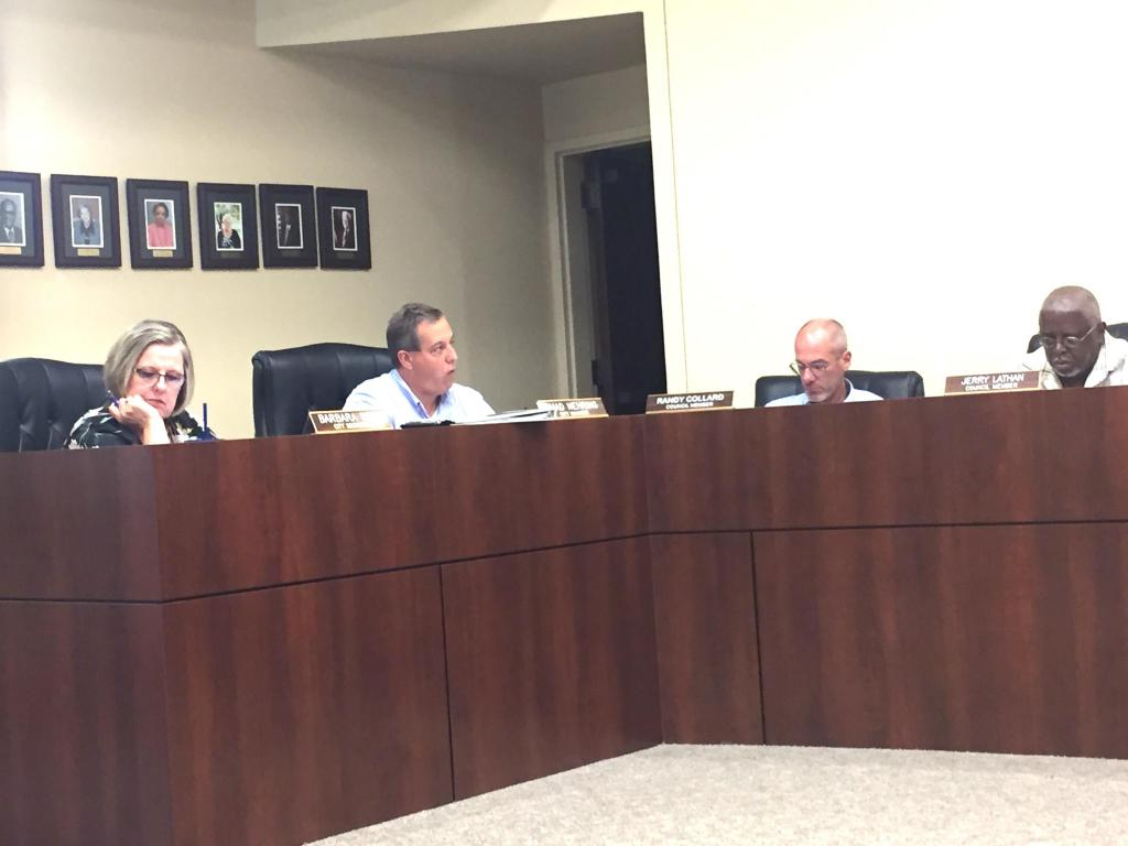 Center City Manager Chad Nehring, second from left, told city council it was the staff's recommendation they approve a revised bid for downtown streetscape.
