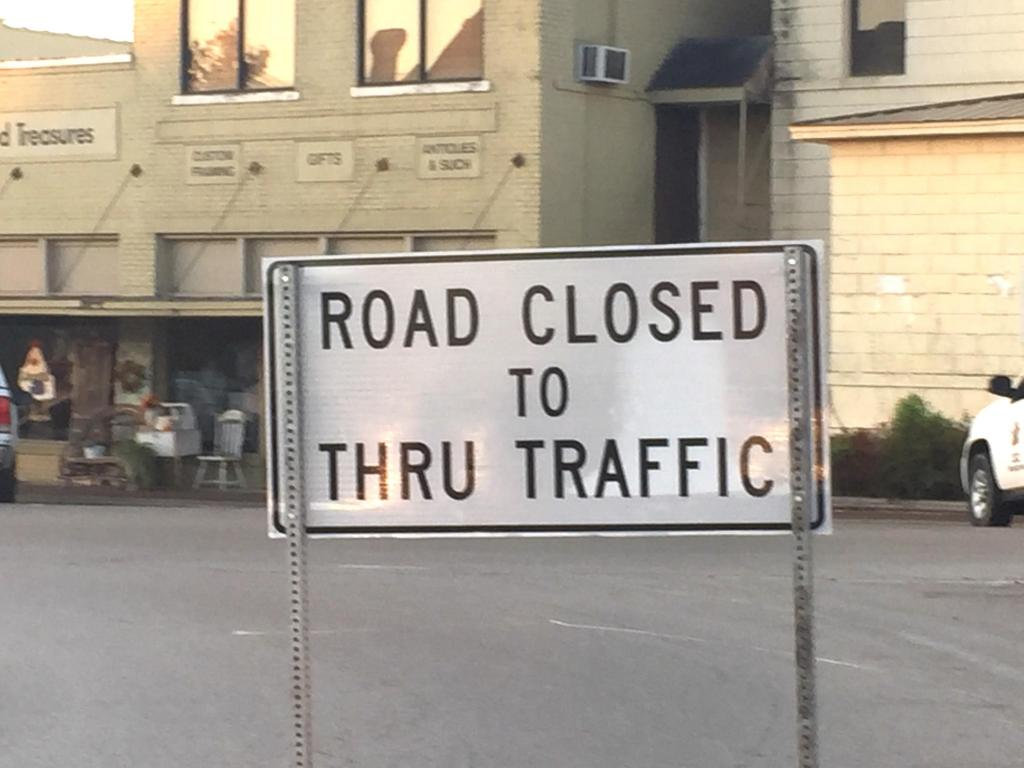 Road closed to thru traffic sign went up Tuesday at Austin & Nacogdoches streets.