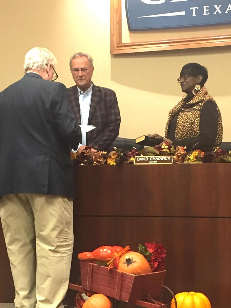Municipal Judge Grover Russell swears in Howell Howard and Joyce Johnson for new terms on the Center City Council on Nov. 11.