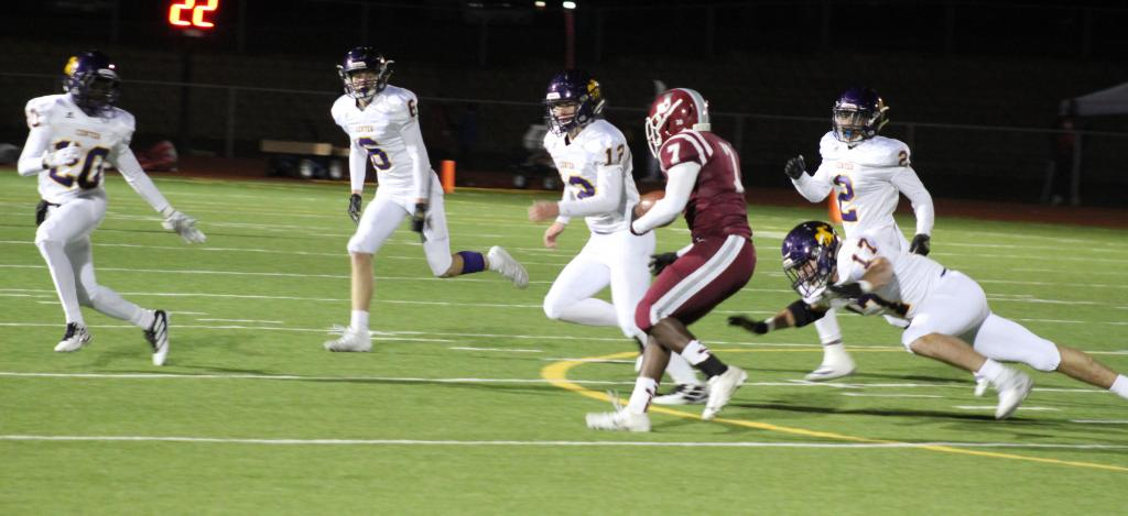 Jake Liker, No. 17, makes a diving tackle on a Jasper ball carrier last Friday. He is the team leader in tackles.