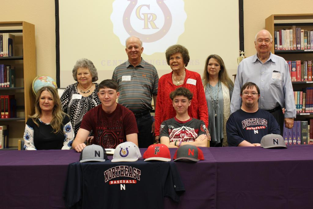 (Seated from left to right): Michelle Covington, Jaxon Covington, Jace Covington, and Jacob Covington pose with family following the signing ceremony. Photo: I'Ceyonna Ware