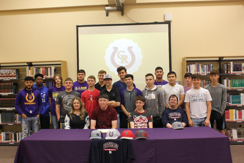 (Seated from left to right): Michelle Covington, Jaxon Covington, Jace Covington, and Jacob Covington pose with members of the baseball team following the signing ceremony. Photo: I'Ceyonna Ware