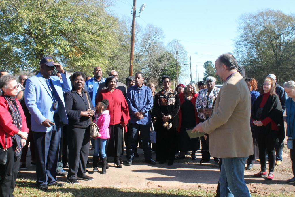 A crowd estimated at about 100 people attended the lynching marker dedication.