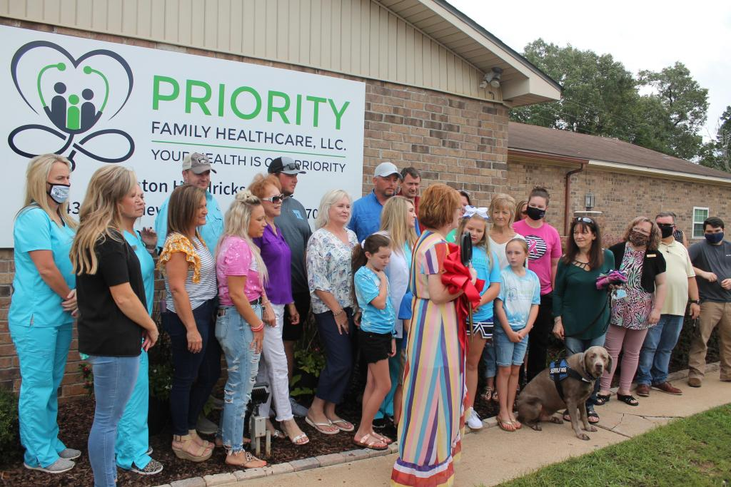 Priority Family Healthcare owner Carriston Hendricks, FNP-C, was joined by a large group of family, friends, Shelby County Chamber of Commerce representatives and others at a grand opening ribbon cutting event held Monday morning, July 27