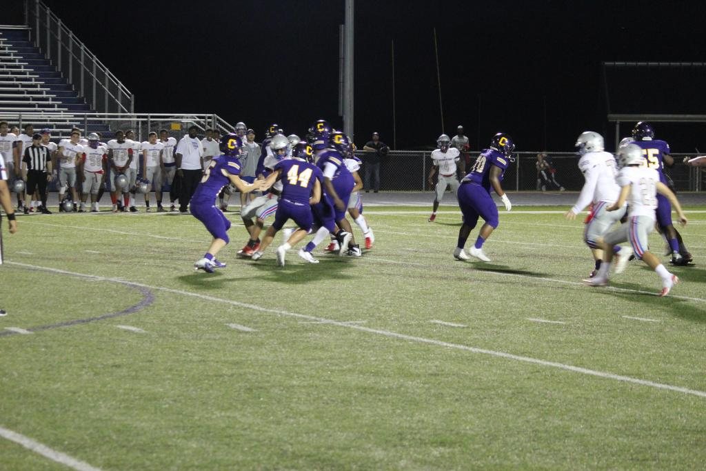 Center JV's Brayden Britt, No. 44, takes a handoff from QB Dean Lester; Britt was the leading rusher for Center in the game.