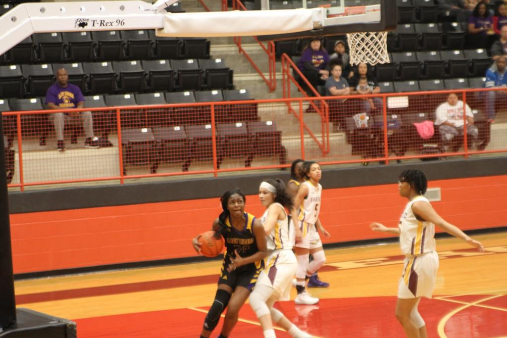 The Lady Roughriders' Ja'kayla Parks pushes her way to the rim during the team's 73-34 defeat to Fairfield Monday night.