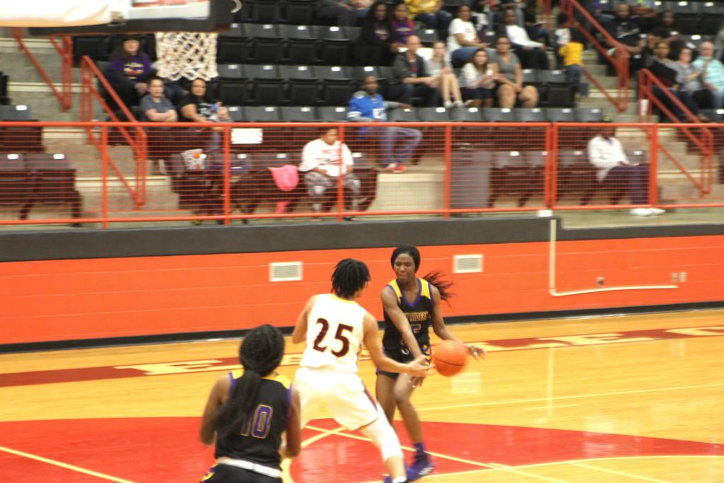 Lady Rider guard Kiddra Harper pushes the pace and finds the right pass during Center's Bi-District contest.