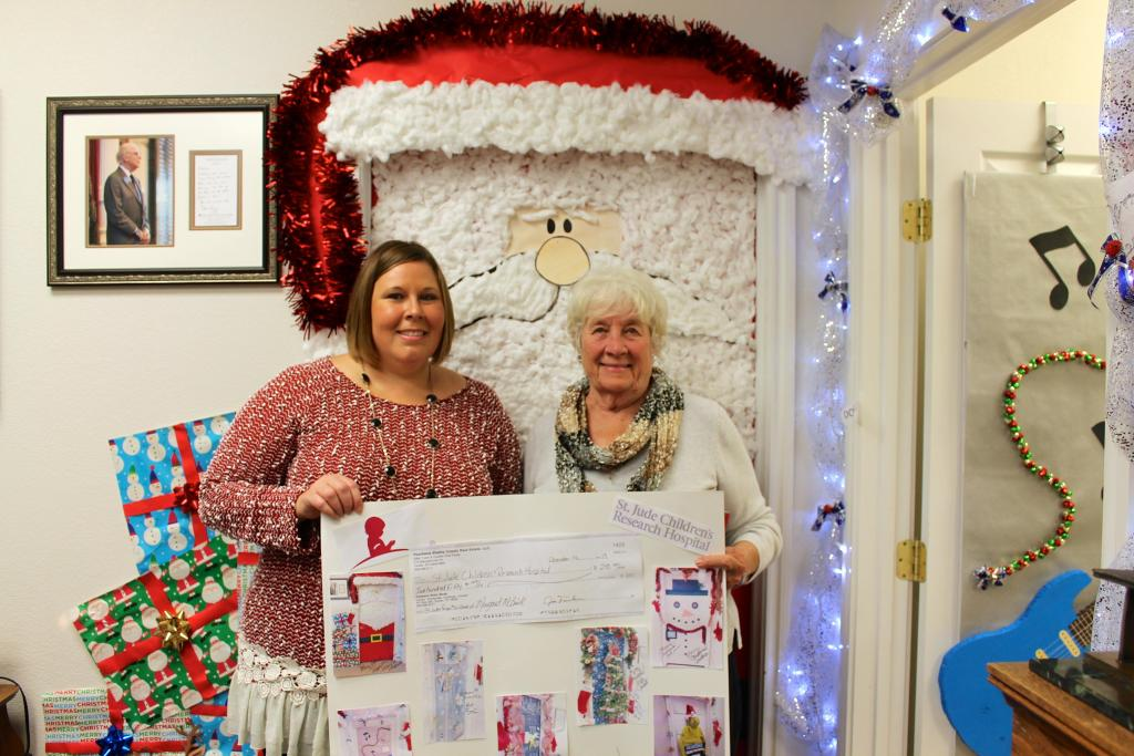 Margaret McBride was the winner of the door decorating contest. Her Santa Clause door earned her $250 cash as well as $250 donated to St. Jude Children's Hospital, donated in her name.