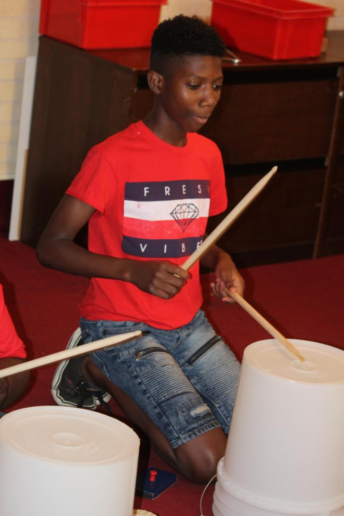 Scenes from June 6 program titled Alien Drum Beats