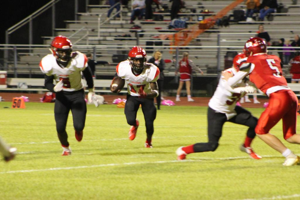 Jaylon Brinson looks for an opening downfield as he takes advantage of a block from #30 Hagan Crumpton. Brinson stepped into the quarterback position for an injured Jordan Boykins and helped lead the Dragons to a 16-2 victory over Deweyville. (Photo by Taylor Bragg)