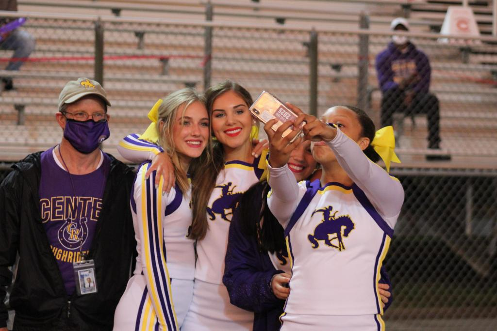CHS Principal Dr. Bryon Miller gets his photo taken with several CHS cheerleaders.