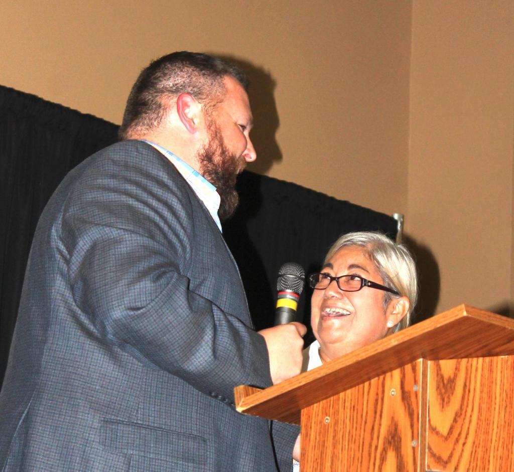 Outgoing Chamber Chairman Brian Dean presented Rose Spector with the Chairman's Award.