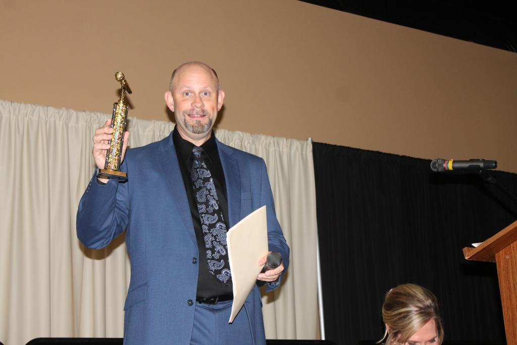 "Master of Ceremonies Chris Watlington received a ""Golden Mic Award"" for his years of service as community events emcee."