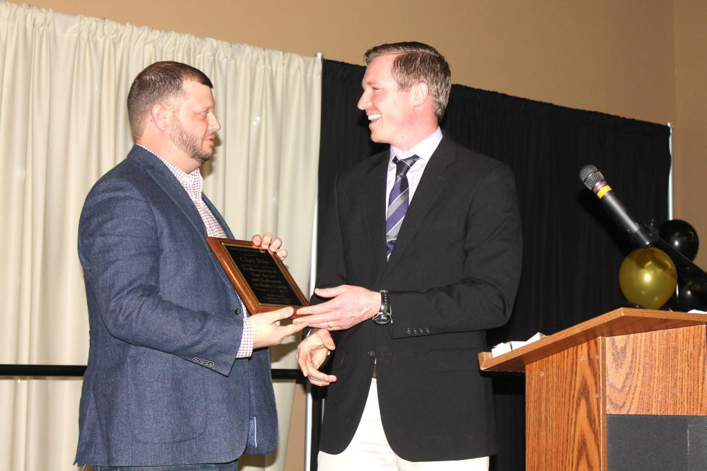 Clay Ihlo, left, received the Young Citizen of the Year Award by Clayton Paul Windham.