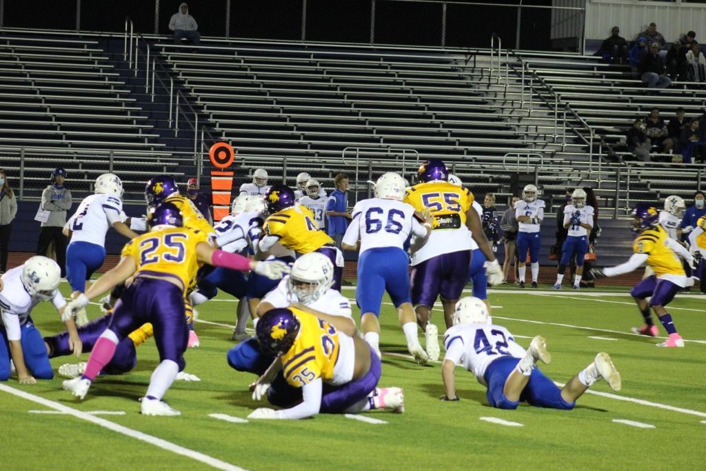 The Roughriders defense put pressure on the Shepherd offense throughout this past Friday's game at Roughrider Stadium. The Pirates were held to one touchdown in the Riders' 56-6 victory. (Mike Elswick/The Light and Champion)