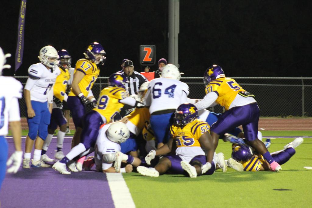 Roughriders defense stops the Pirates at the goal line.