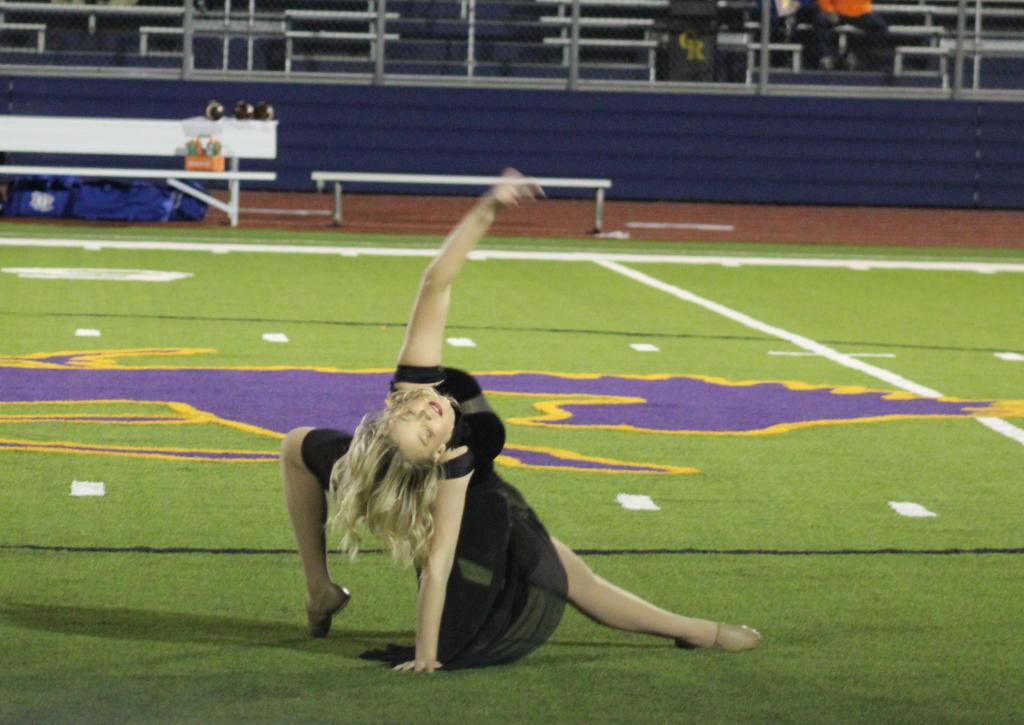 Madie Norvell performed a special dance routine in recognition of Breast Cancer Awareness Month during halftime.