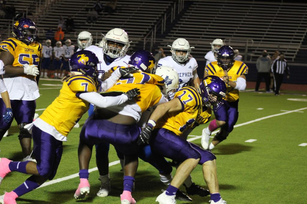 With big defensive plays like this one with Marques Hall, #7; JJ McCollister, #51; and Jake Liker, #17; in on a tackle, the Center defense held the Shepherd Pirates to crossing the end zone only one time this past Friday. (Mike Elswick/The Light and Champion)