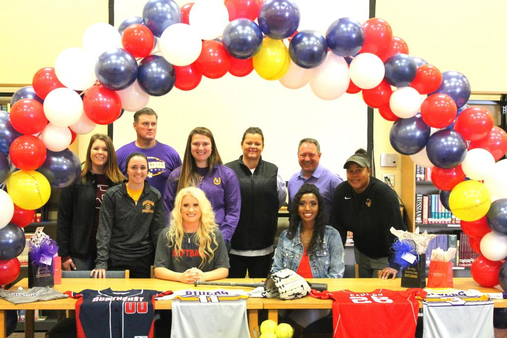 Lady Rider standout athletes Kalei LaRock, seated left, and Jaemine Cooks, seated right, signed college letters of intent Monday for NTCC,