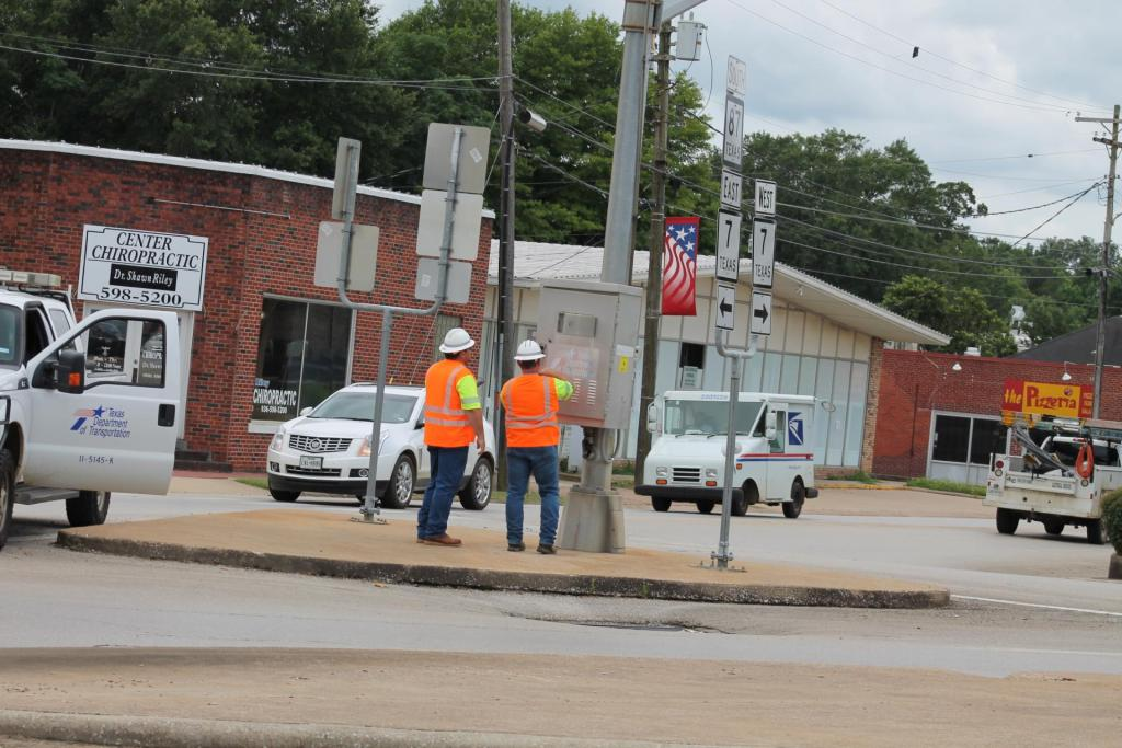 TxxDOT crews were busy Monday on the downtown square switching traffic lights over to flashing red mode.