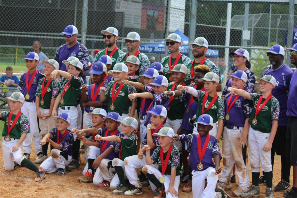 Center and Livingston All-Stars pose with their medals and rings.