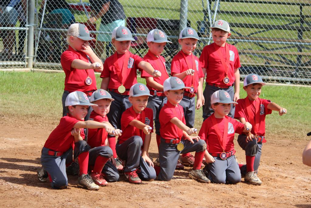 Shelbyville T-Ball All-Stars with runner-up medals and rings.