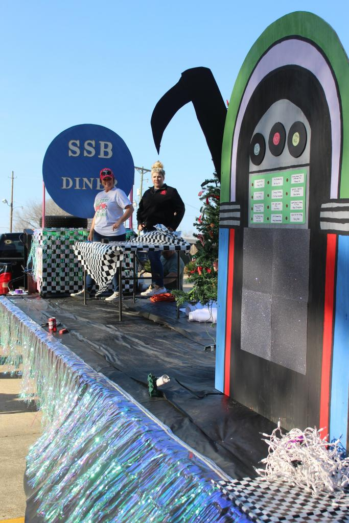 Workers prepare the Shelby Savings Bank float, which was the top entry in the business category