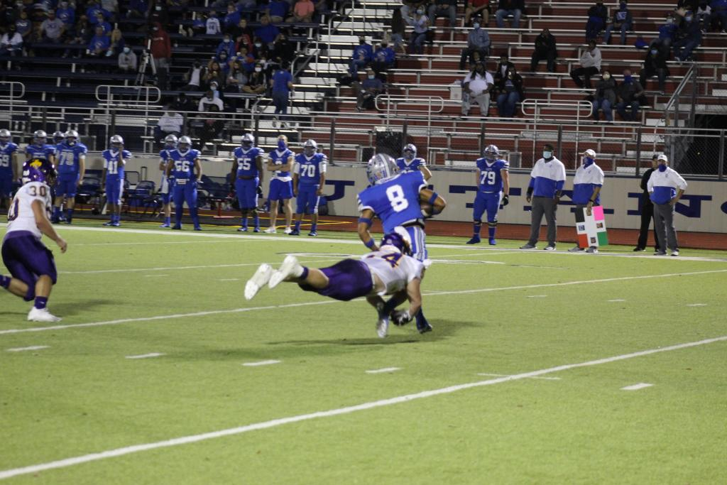 Chase Adkison, No. 54 for Center, takes a flying leap at a Waco Connally Cade ball carrier in Friday's 31-30 Roughrider victory in a playoff game held in Madisonville. (Mike Elswick/The Light and Champion)