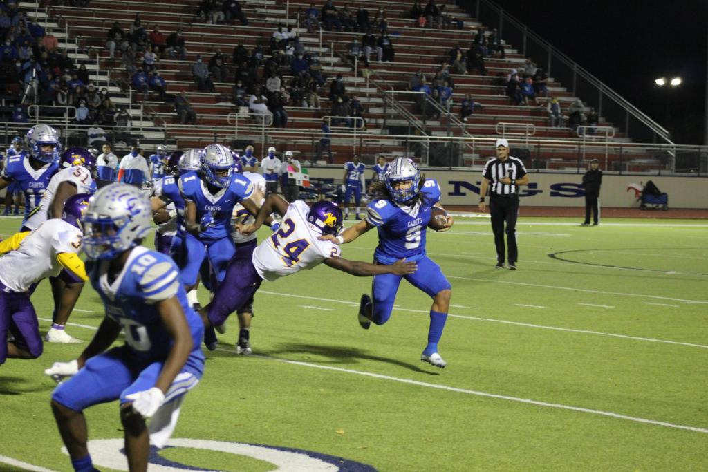 Center's Timothy Davis, No. 24, stretches as he leaps in an effort to stop a Connally Cadet ball carrier in last week's playoff game in Madisonville. (Mike Elswick/The Light and Champion)