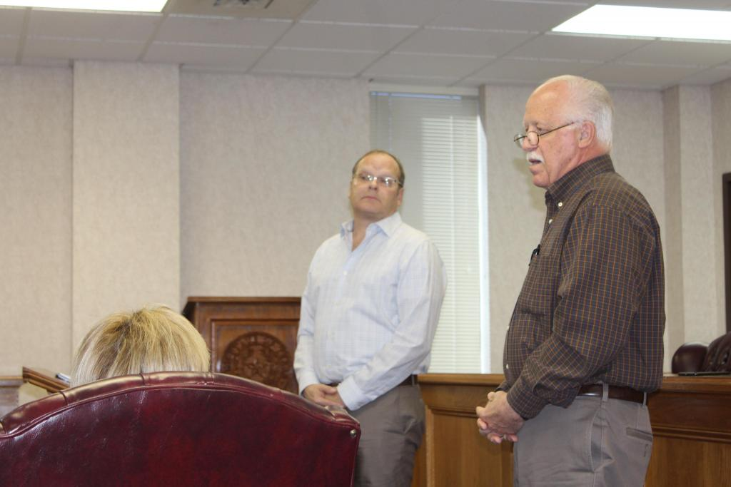 Shelby County Historical Commission Chairman Teddy Hopkins, foreground, addresses county commissioners last week.