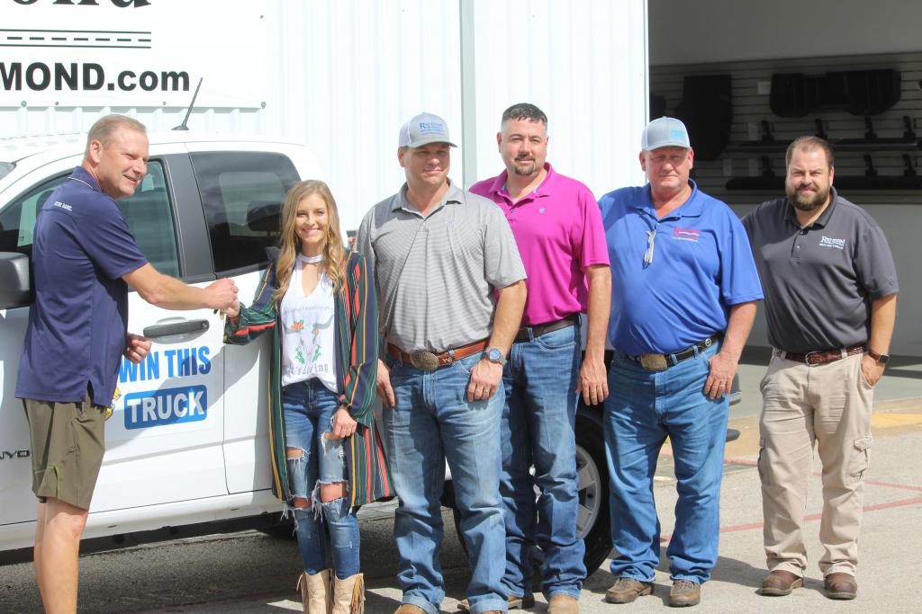 Tim Wulf is seen presenting Taylor Clark with the keys to the 2018 GMC Pickup she won in a raffle of the Center Noon Lions Club. On hand for the event were Raymond Motor Co. representatives Will Blackwell, J.B. Raymond, Rusty Young and Michael Holt. Wulf served as chairman of the Lions Club fundraiser.