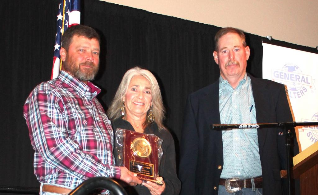 Farm Family of the Year recipients Waylon and Margo Griffith with Lane Dunn, county extension agent.