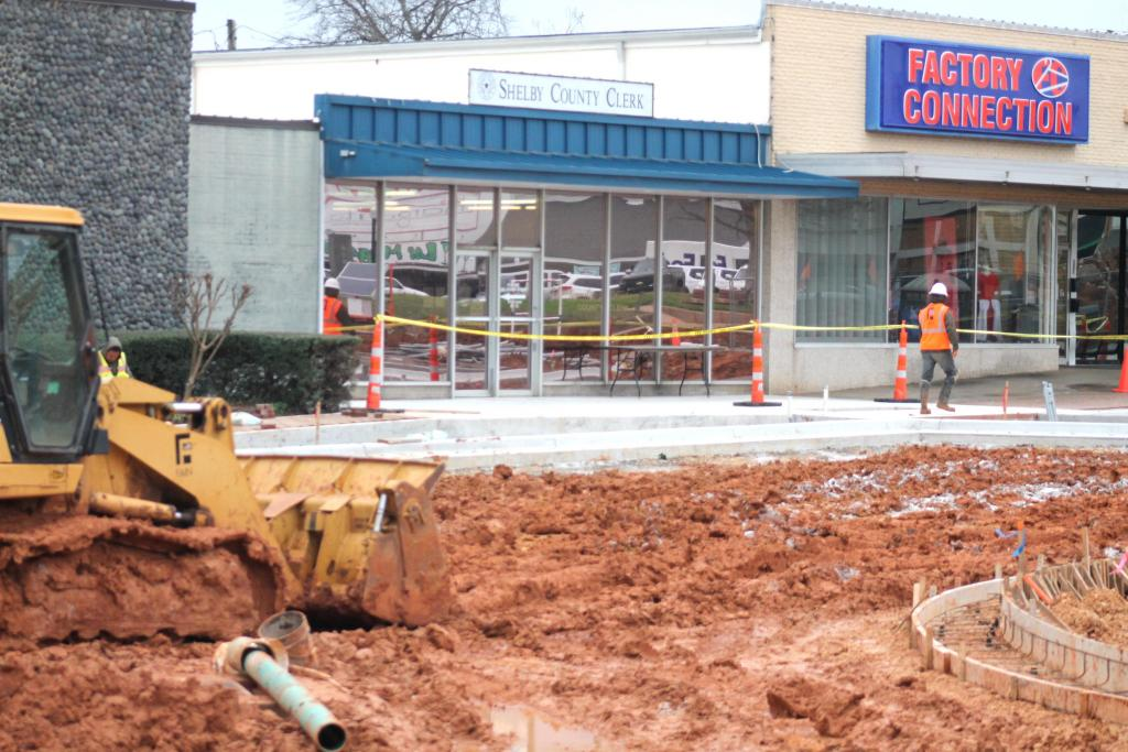 Street and sidewalk construction in downtown Center continues around and in front of the County Clerk's office.
